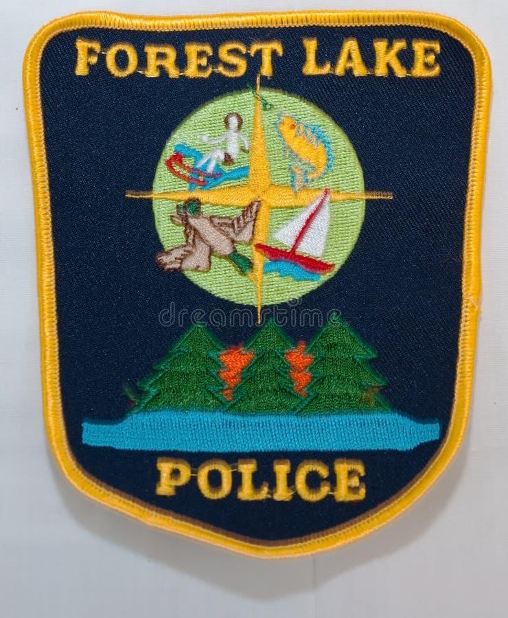 从福里斯特莱克警察局的肩章在明尼苏达州人 库存图片
