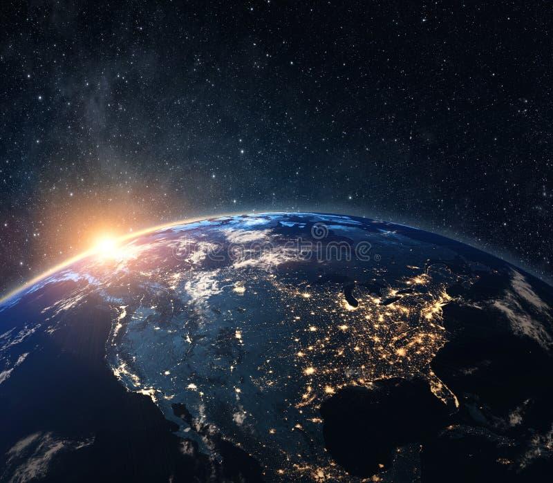 从空间的行星地球在晚上 图库摄影