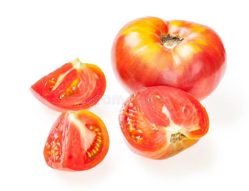 从红色水多的蕃茄的被删去的切片 隔绝在白色backgro 免版税库存图片