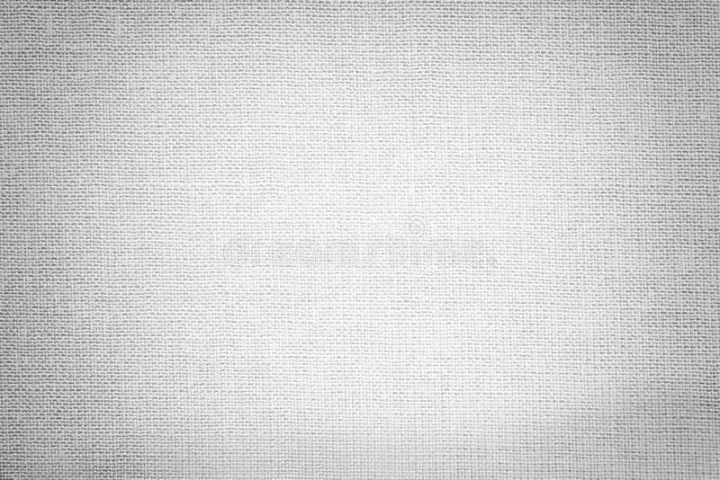 从纺织材料的浅灰色的背景 与自然纹理的织品 靠山 库存照片