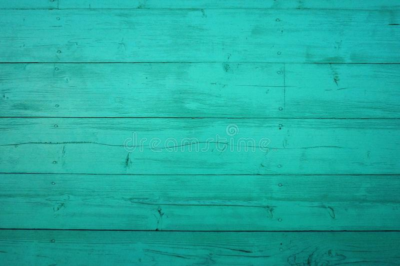 从老破旧的木板的背景 绿松石与剥油漆的木头纹理 库存照片