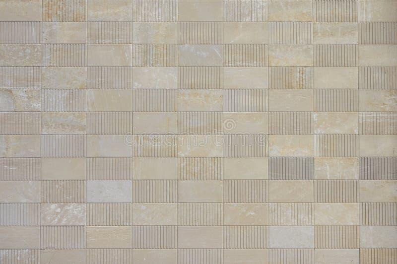从自然石米黄石灰华的纹理瓦片 库存照片