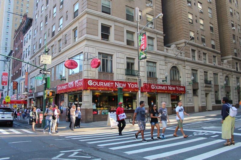 从蟑螂教练的纽约街道到食家nyc有它全部 库存照片