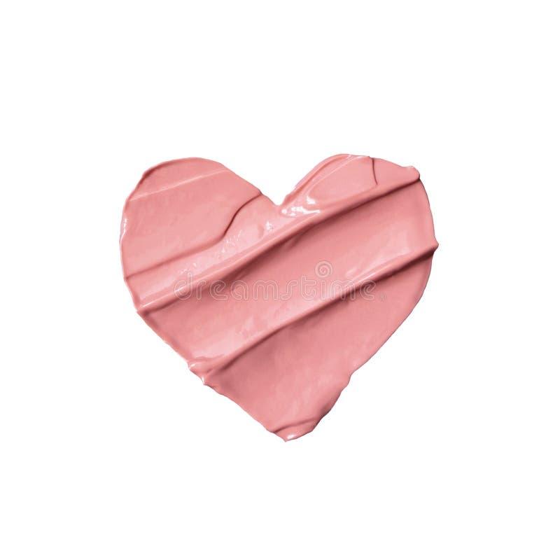 从被隔绝的液体粉色口红的心脏 免版税库存照片