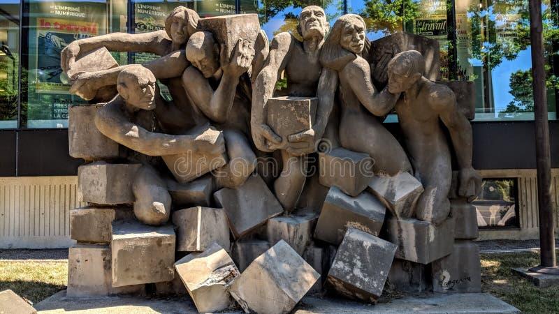 代表努力和工作的石雕塑 免版税库存照片