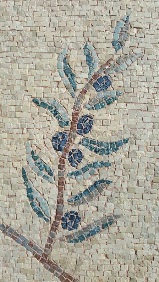 代表橄榄树分支的石马赛克 拍摄在Kos海岛上,希腊 免版税库存图片