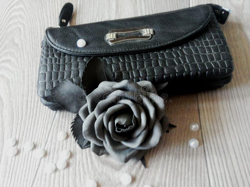 以一朵黑玫瑰的形式别针 图库摄影