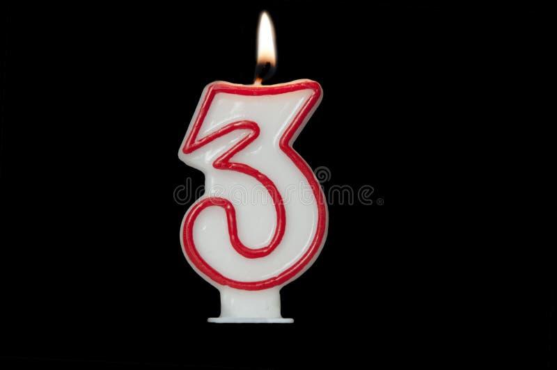 以三的形式生日蜡烛 免版税库存图片