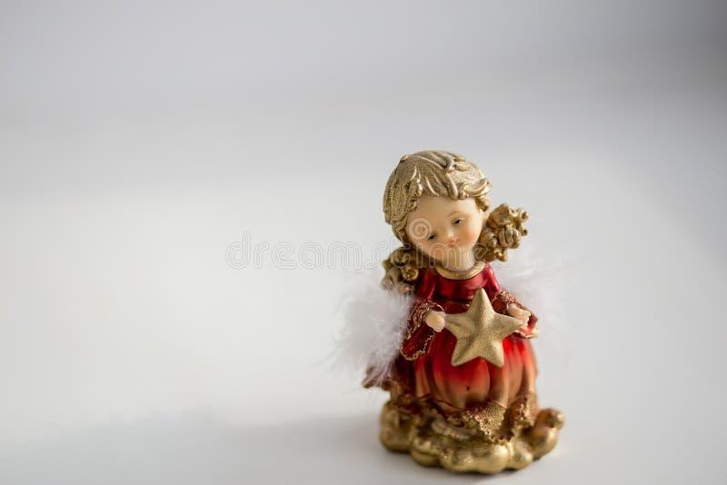 以女孩天使的形式圣诞节装饰装饰 免版税库存图片
