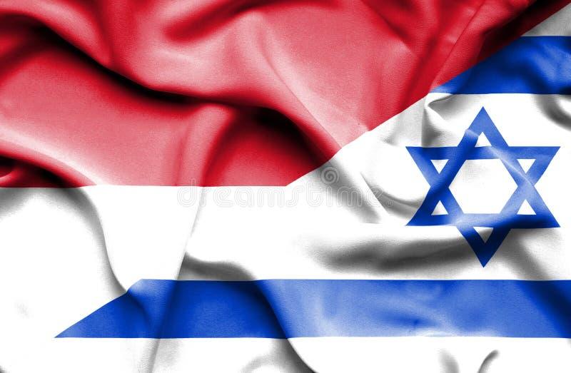 以色列和摩纳哥的挥动的旗子 向量例证