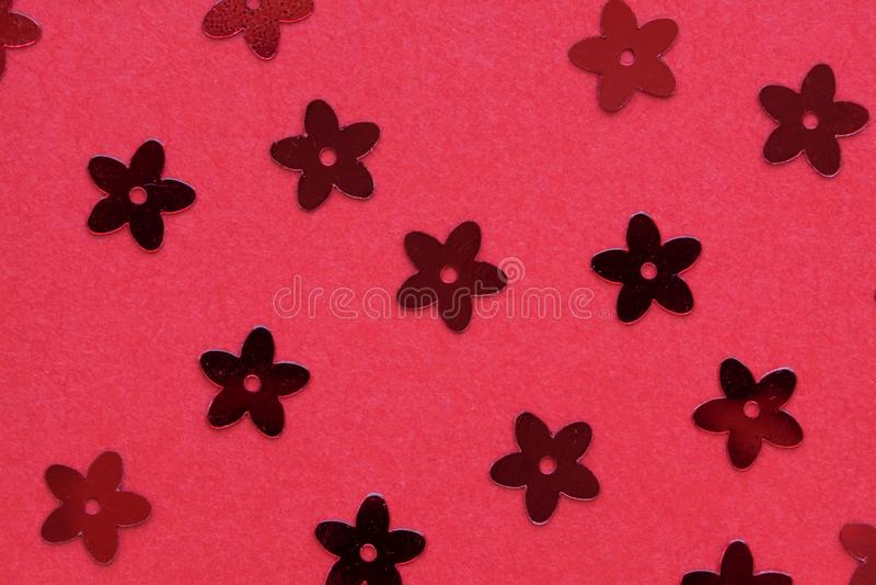 以花的形式红色调色板在红色背景 免版税库存照片