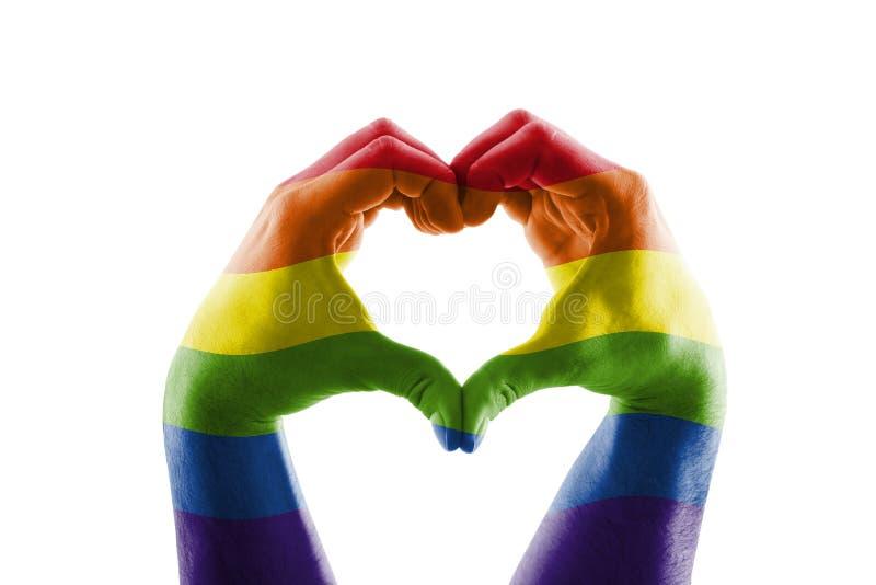 以LGBT彩虹心脏的形式两只手 库存图片