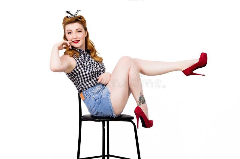 仿照画报样式的一个少妇在椅子 库存照片