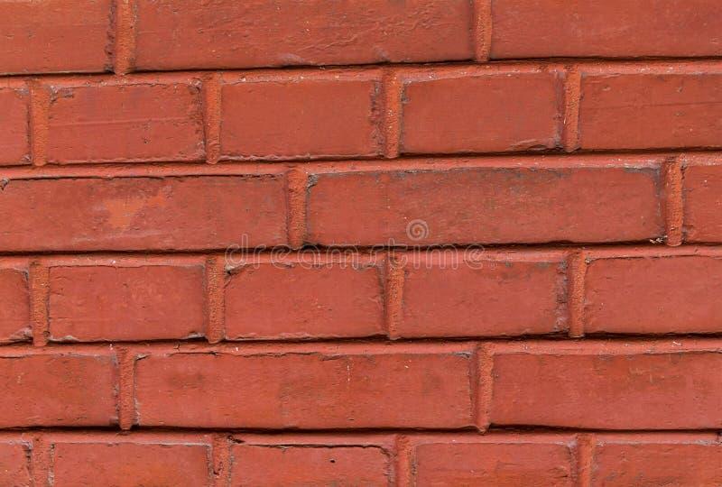 仿造历史的墙壁都市设计基地的砖墙长方形石头被绘的红色赤土陶器色素 库存图片