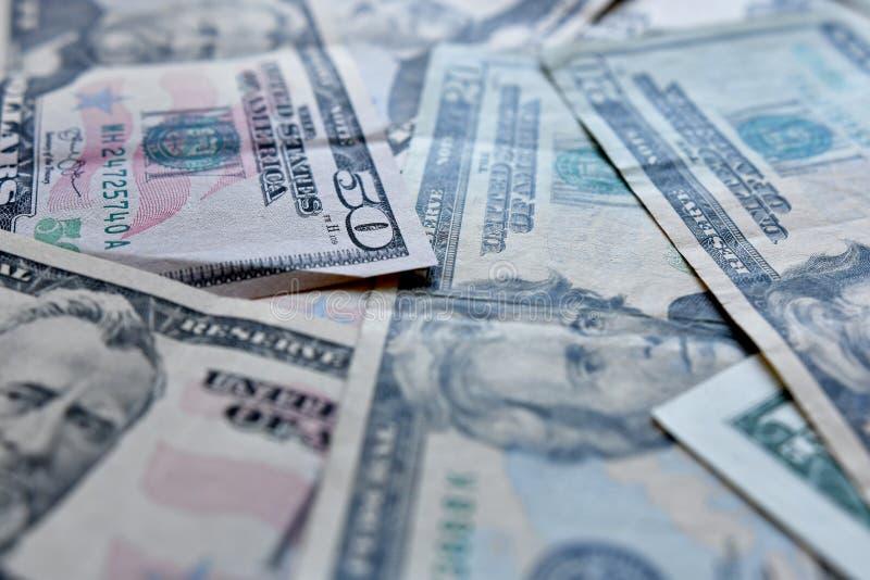 企业、财务、投资、挽救和腐败概念-从美元美国的金钱背景 免版税图库摄影