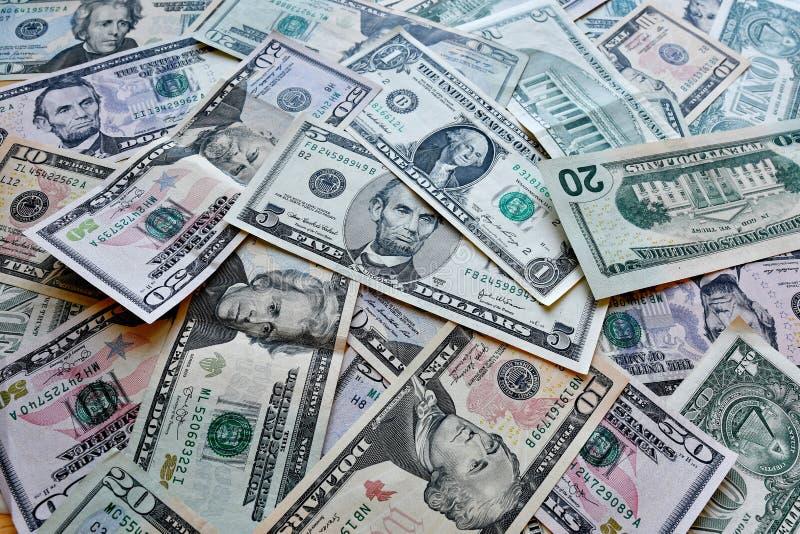 企业、财务、投资、挽救和腐败概念-从美元美国的金钱背景 免版税库存图片