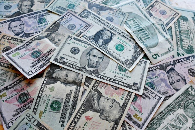 企业、财务、投资、挽救和腐败概念-从美元美国的金钱背景 免版税库存照片