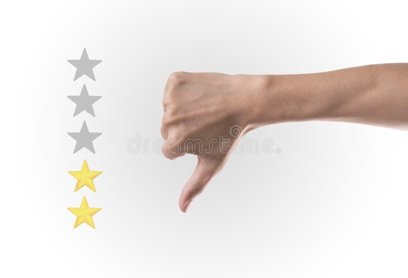 企业下来手拇指与在五个星规定值的黄色标志 库存图片