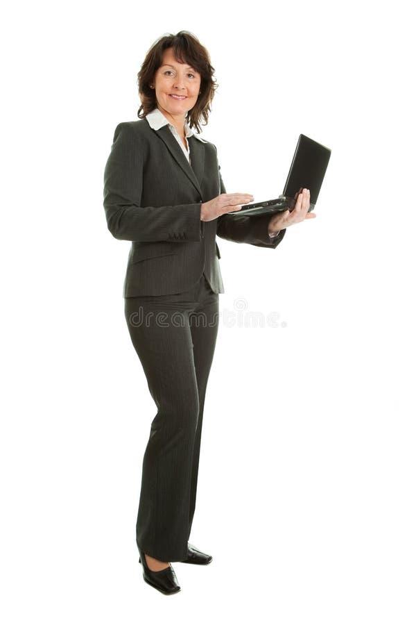 企业使用妇女的膝上型计算机前辈 免版税库存图片