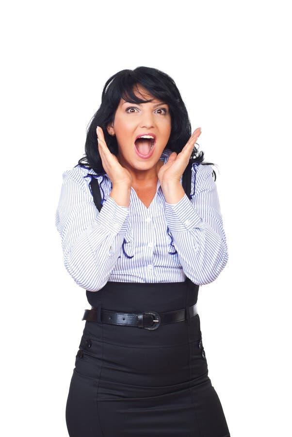 企业呼喊的惊奇的妇女 免版税库存图片