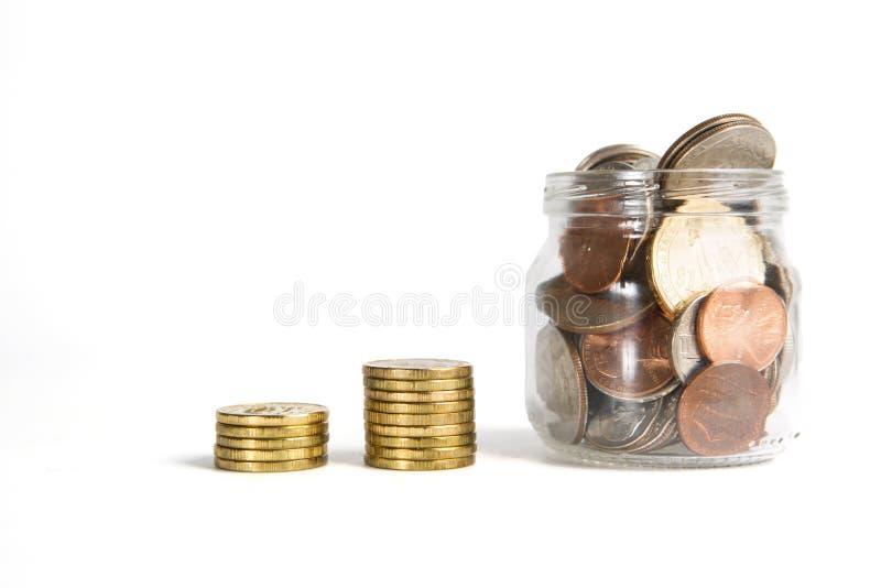 企业图由金黄被隔绝的硬币和瓶子被做 库存图片