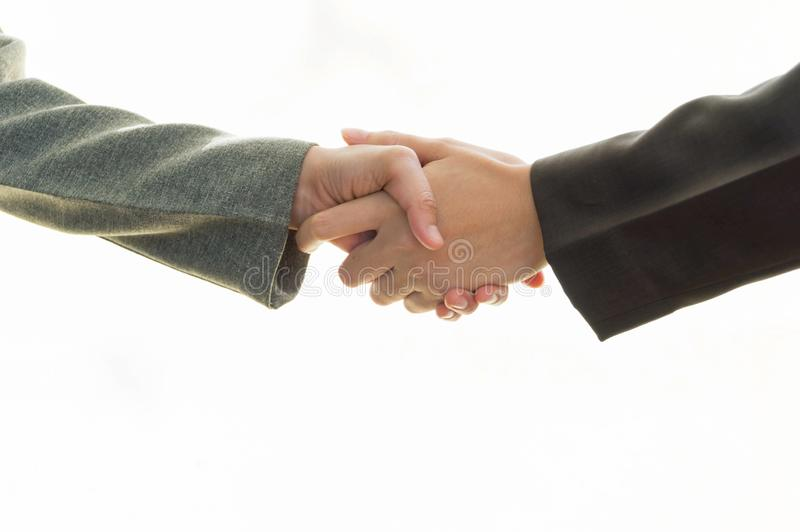 企业夫妇的手握手的 库存图片
