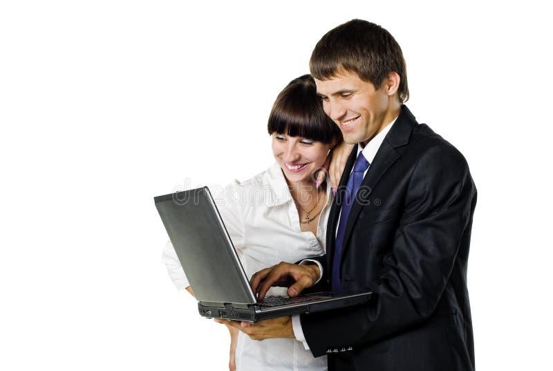 企业夫妇膝上型计算机 库存照片