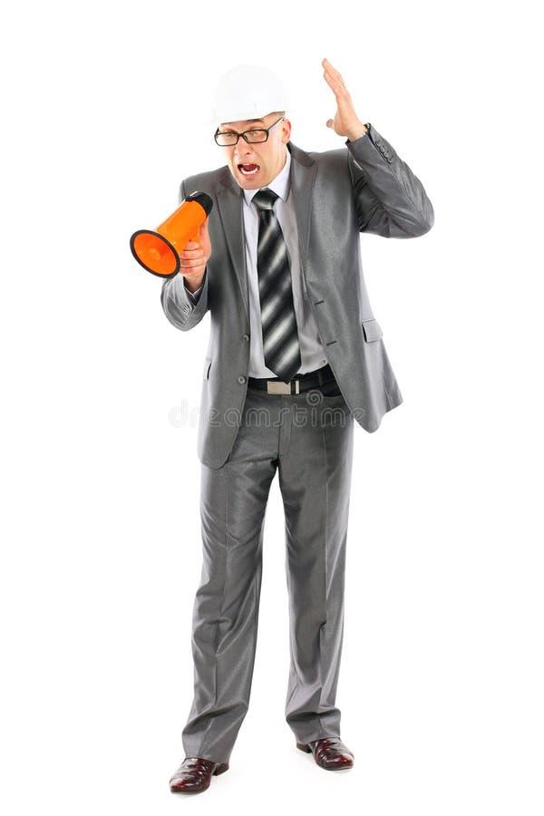 企业安全帽人呼喊的年轻人 免版税图库摄影