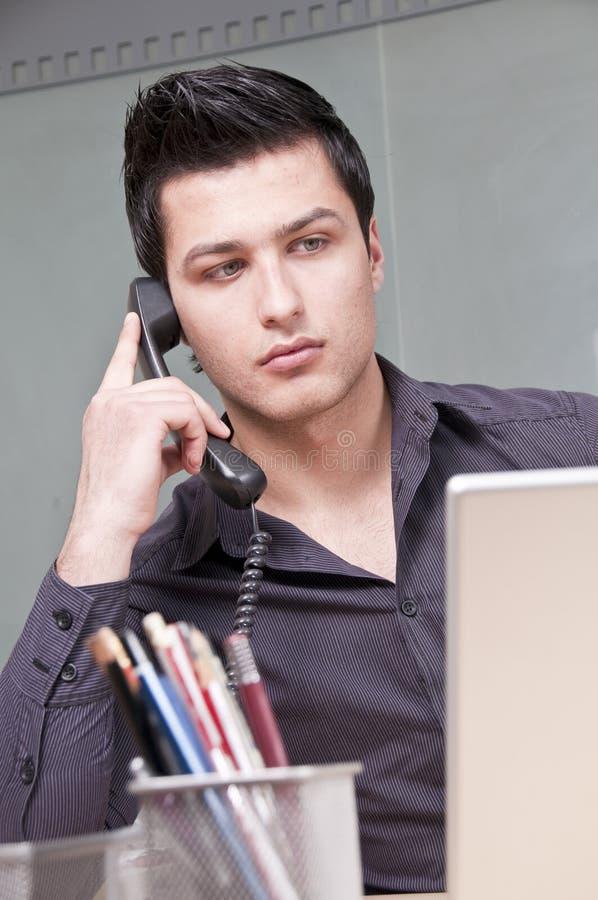 企业家电话年轻人 图库摄影