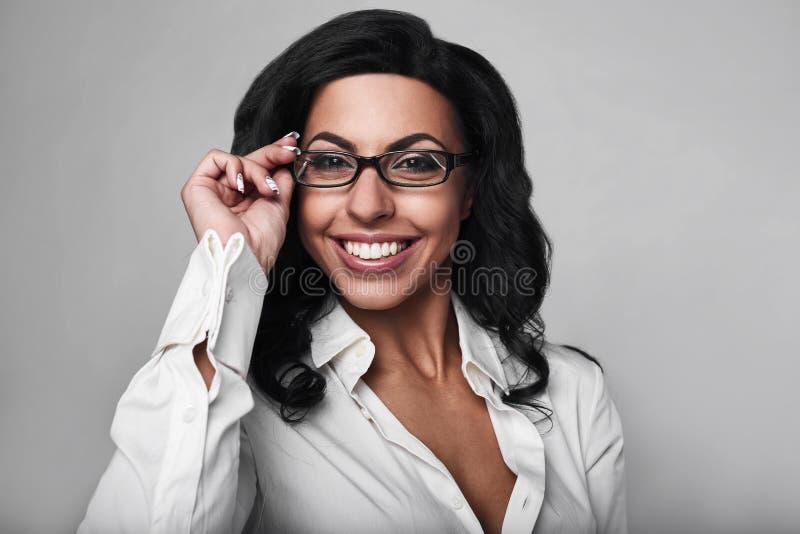 企业愉快的纵向妇女 免版税库存照片