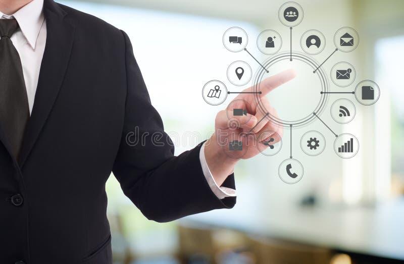 企业指向视觉象的商人的技术手 免版税库存照片