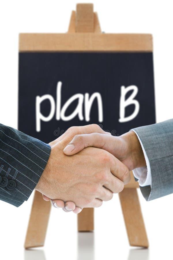 企业握手的综合图象反对计划b的 免版税库存图片