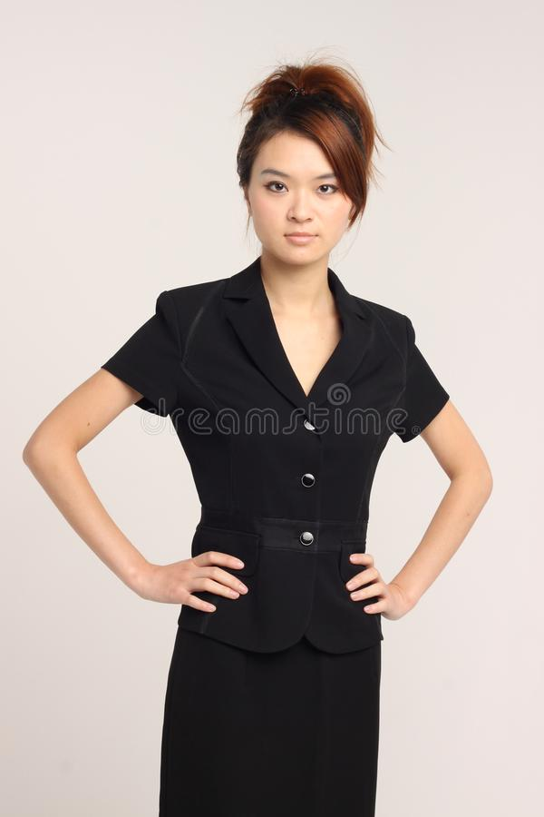企业服装中性表示的亚裔夫人 免版税库存照片