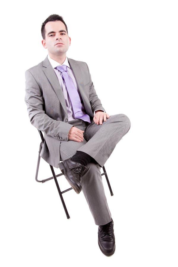 企业椅子人坐的年轻人 库存图片