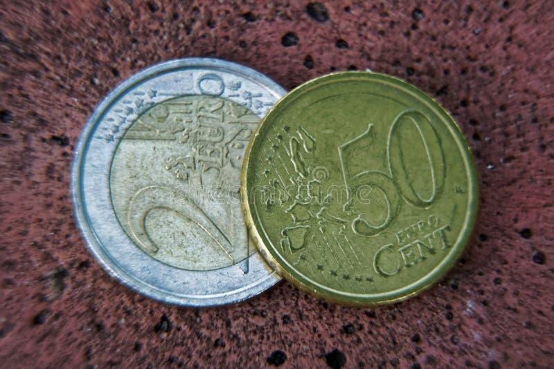 企业概念、宏指令两欧洲硬币和50分 免版税图库摄影