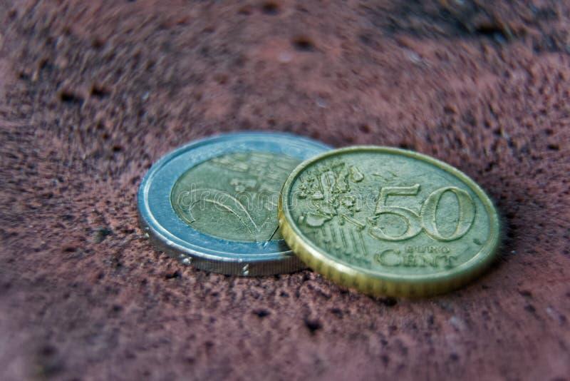 企业概念、宏指令两欧洲硬币和50分 库存照片