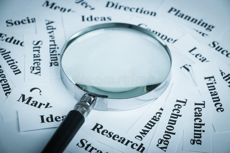 企业概念绘制图象聚焦检查镜扩大化的远见 免版税图库摄影