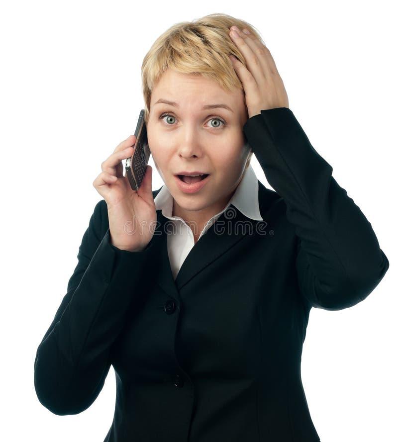 企业电话震惊谈话妇女年轻人 图库摄影