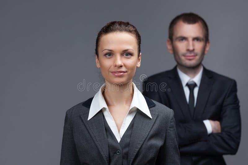 企业男性和女性伙伴画象  库存照片