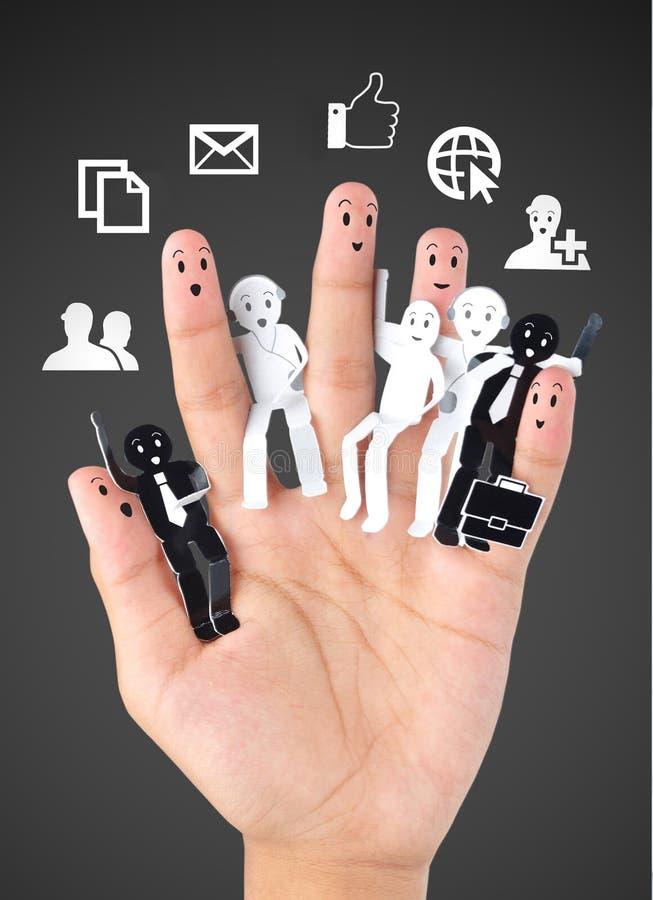 企业社交网络的标志的微笑的手指 免版税库存照片
