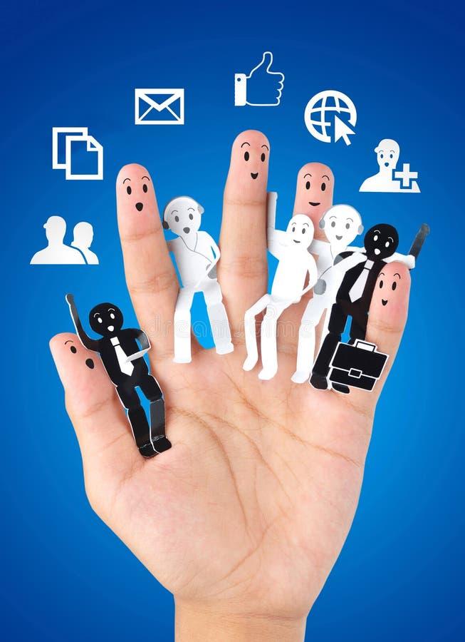 企业社交网络的标志的微笑的手指 库存图片