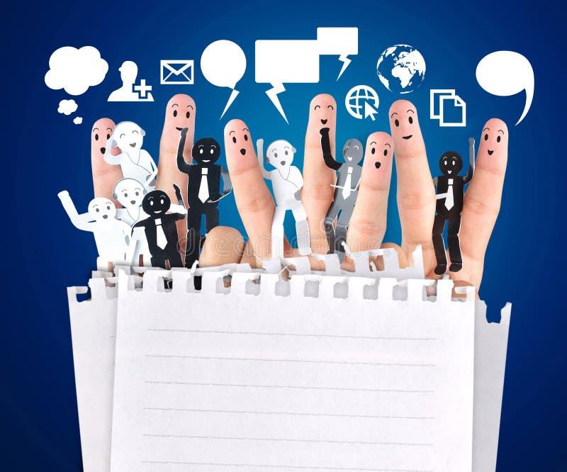 企业社交网络的标志的微笑的手指 库存照片