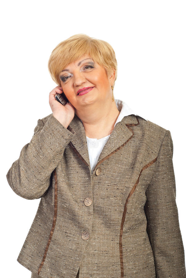 企业移动电话成熟微笑的妇女 库存图片