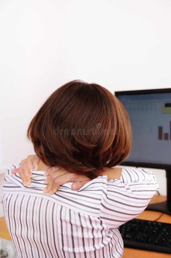 企业脖子痛妇女 库存图片