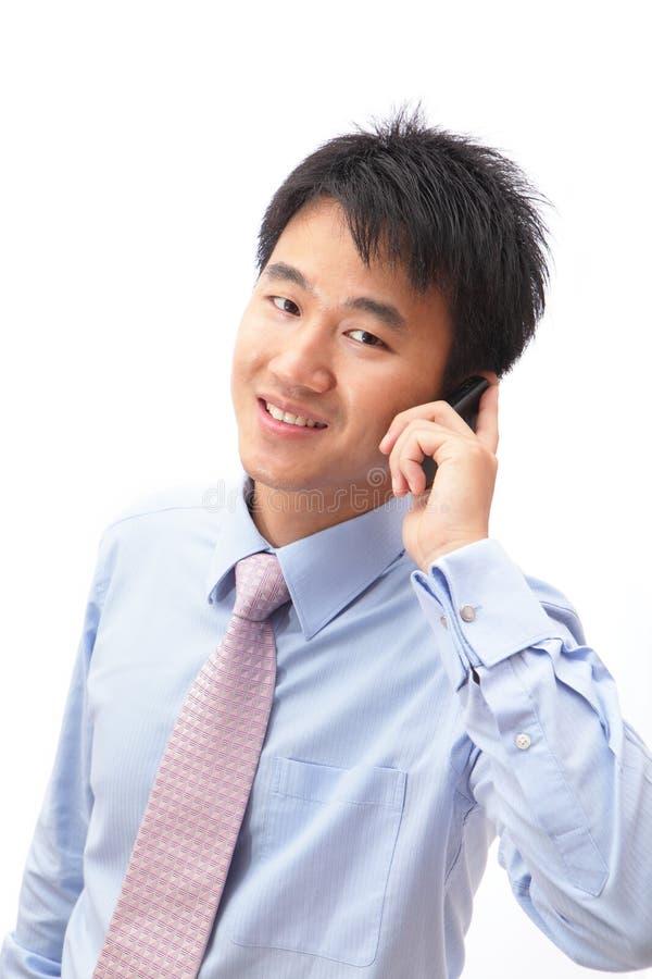 企业英俊人电话纵向告诉 免版税图库摄影