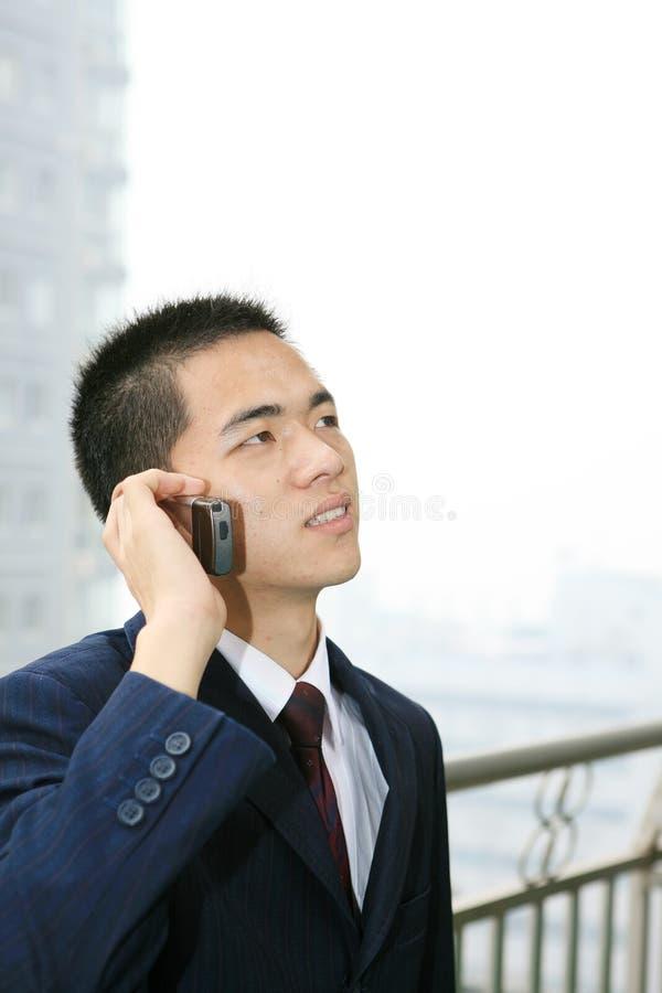 企业藏品人移动电话年轻人 库存照片