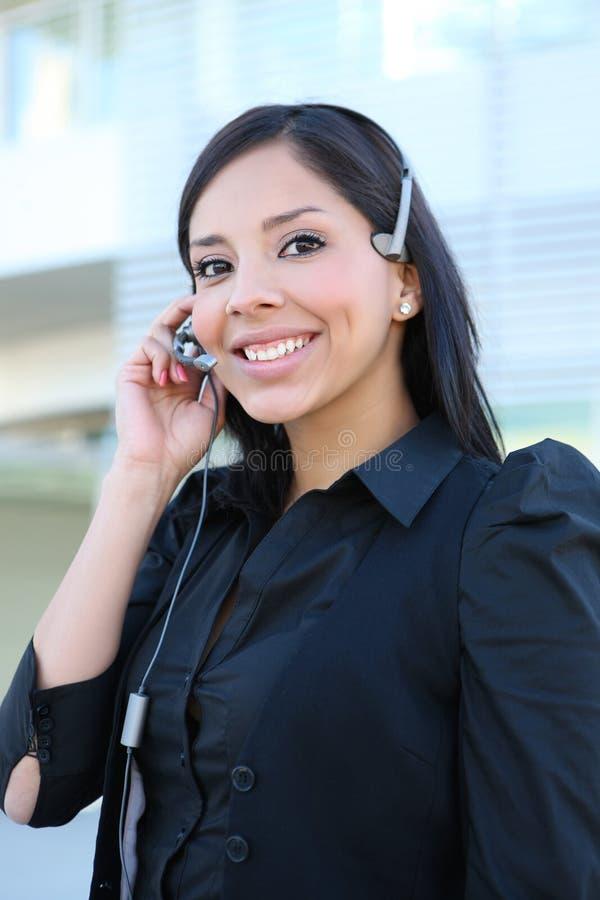 企业西班牙电话妇女 库存照片