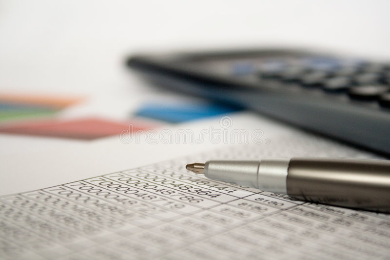 企业计算器关闭计算笔  免版税库存照片