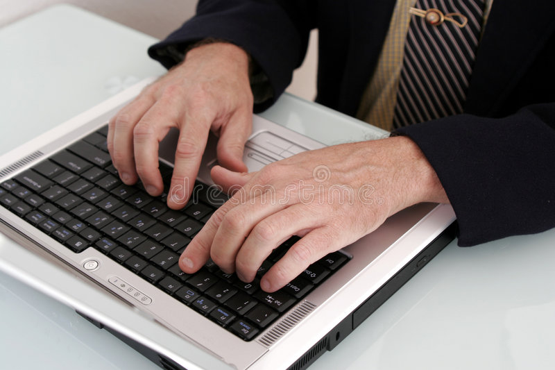 企业计算机人笔记本工作 库存照片