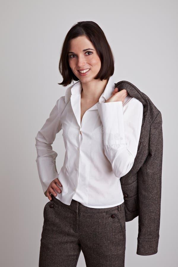 企业运载的夹克妇女 图库摄影